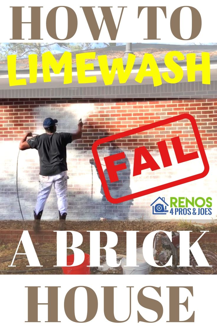 man using a paint sprayer to apply limewash paint to the exterior of a red brick house